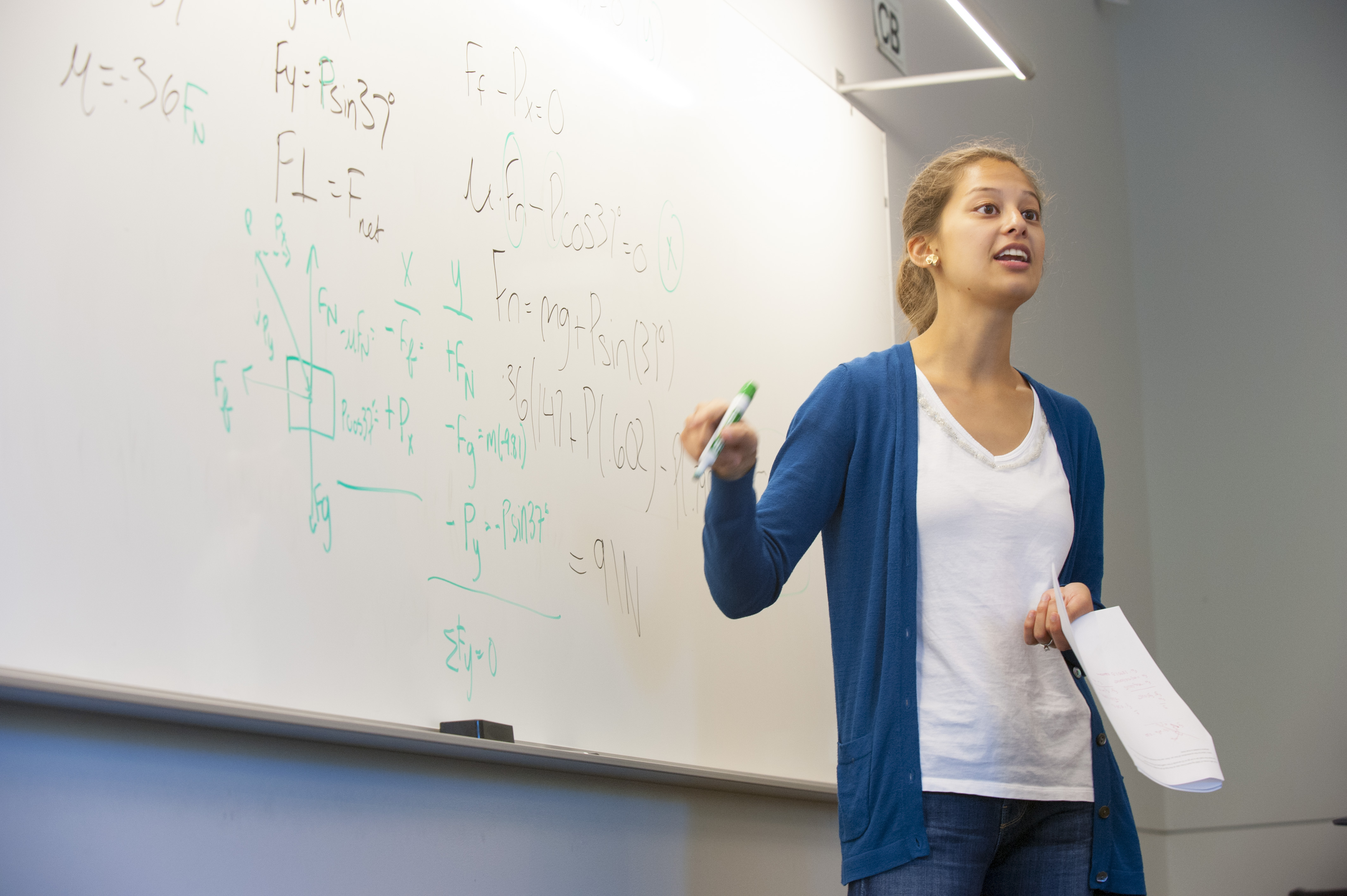A faculty member works on a math problem during class in Laurel Hall on July 29, 2014. (Sean Flynn/UConn Photo)