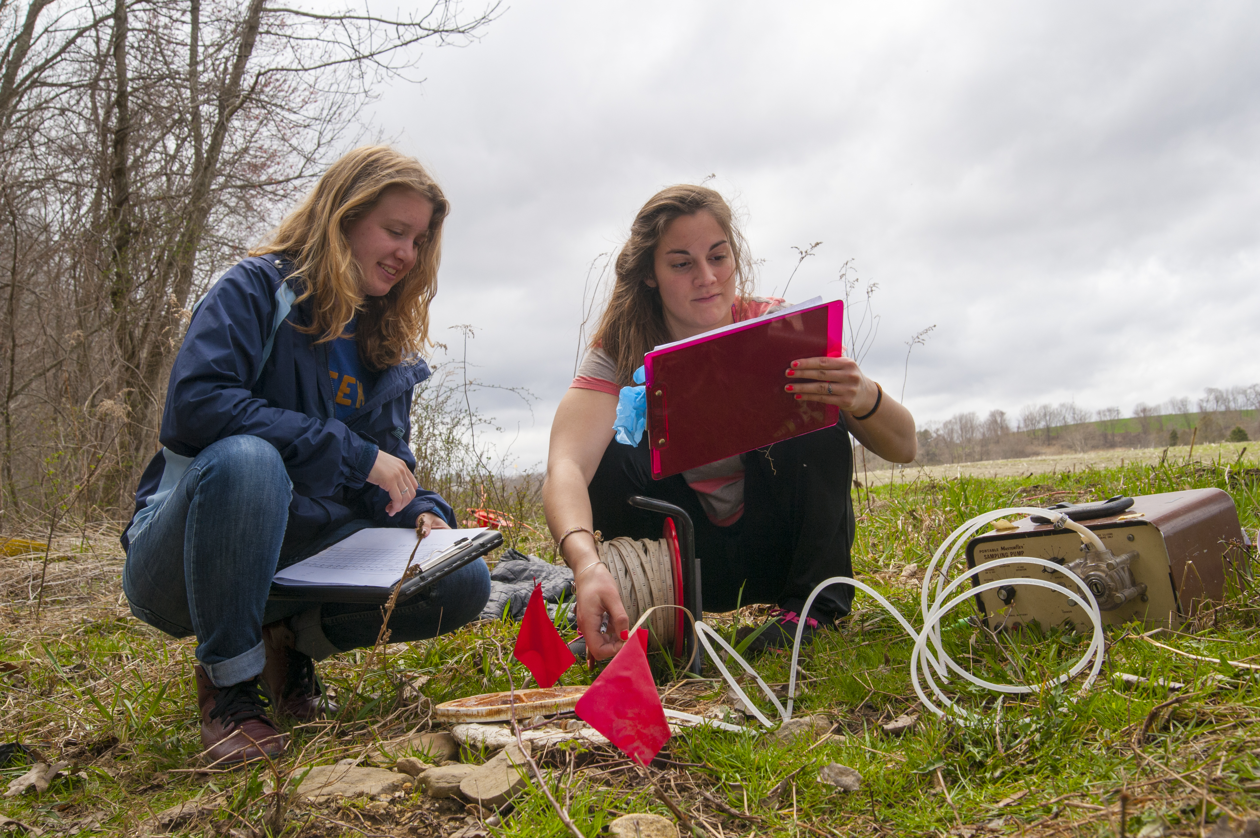 At left, Cecily Varvitsotis, '14, Abigal Valletta '13, take water samples during field methods in hydrogeology class April 19, 2013. (Sean Flynn/UConn Photo)